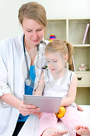 Pediatrician and little girl