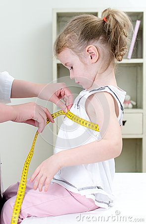 Pediatrician measuring toddler s chest