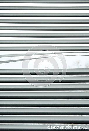 Peeking through venetian blinds
