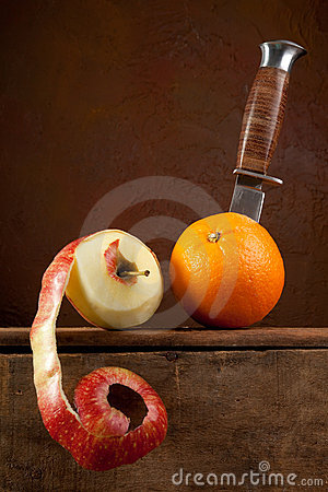 Peeled fruit on a dagger