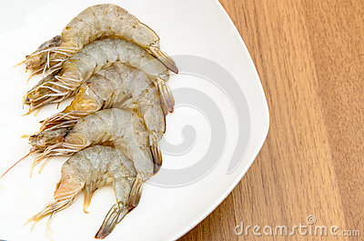 Peeled shrimps in white dish
