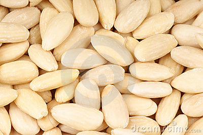 Peeled sweet almonds background