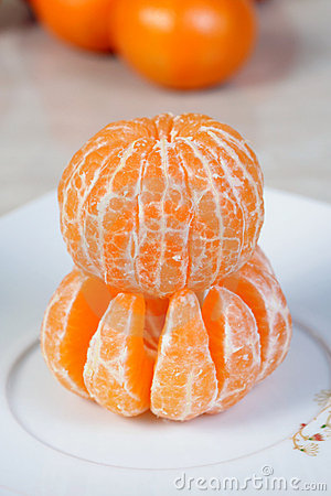 Free Peeled Tangerines On The Plate Royalty Free Stock Images - 7326069