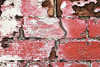 Peeling old painted brick wall