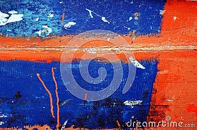 Peeling paint on rusted metal surface