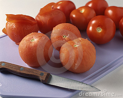 Peeling the tomatoes