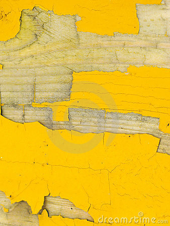 Peeling yellow paint on wood