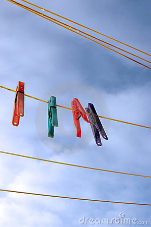 Pegs on a wet washing line