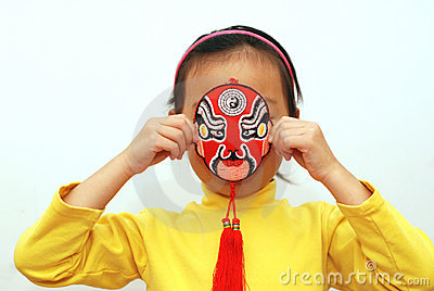 Peking Opera mask and little girl