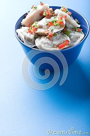 Pelmeni on blue Stock Photo
