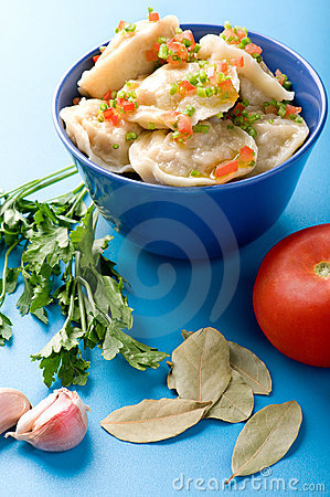 Pelmeni with garlic and bay leaf close up Stock Photo