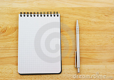 Pen and blank note pad