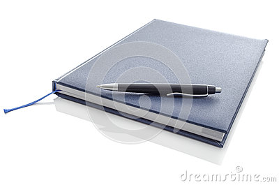 Pen on blue notebook