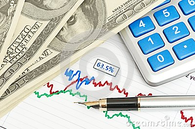 Pen,calculator and dollars on chart closeup