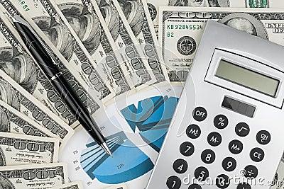 Pen,calculator and dollars on chart closeup