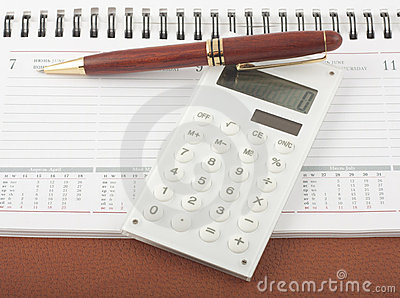 Pen and calculator on open diary notepad