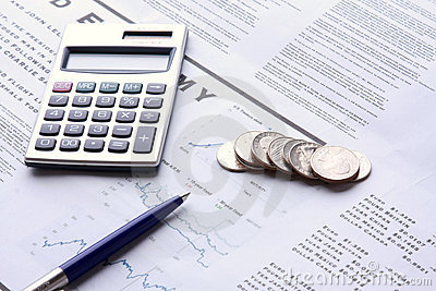 Pen, coins and calculator