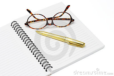 Pen and eyeglasses on a notebook