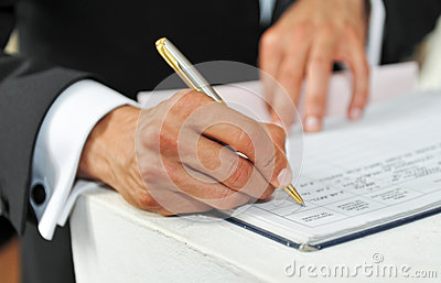 Pen In Hand Of Man Writing On The Notebook Royalty Free Stock Photos - Image: 25160448