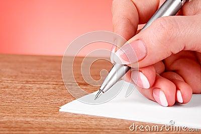 Pen in hand writing