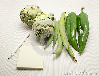 Pen Notebook and Fresh Vegetables