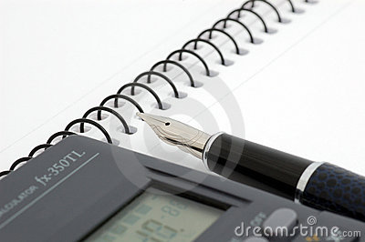 Pen, notepad and calculator
