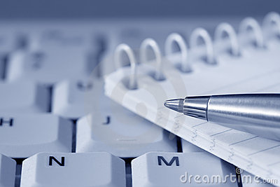 Pen and Notepad on Keyboard