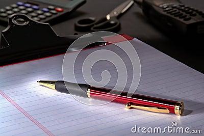 Pen on Notepad Paper Sheet
