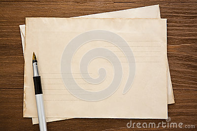 Pen and old postal envelope