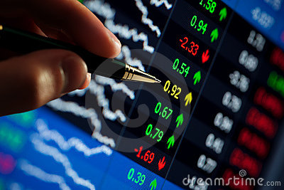Pen pointing at stock prices