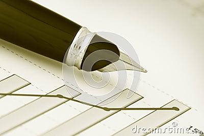 A pen on positive earning chart(y)