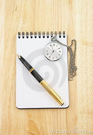 Pen, watch and blank note pad