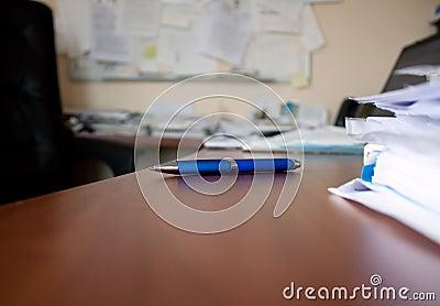 Pen on wood desk