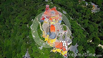Aerial footage. Palace of Pena, Sintra, Lisbon, Portugal. The Pena Palace Portuguese: Palácio da Pena is a Romanticist castle in São Pedro de Penaferrim stock footage