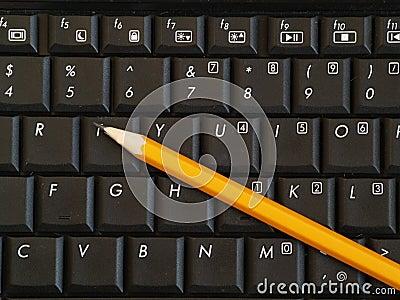 Pencil on computer keyboard
