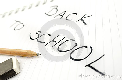 Pencil on notebook with Back to school text
