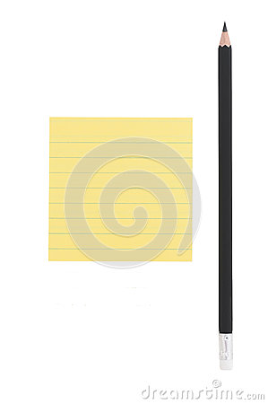 Pencil and post-it note on white background