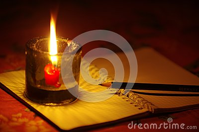 pencil put on notebook with candle light stock photo. Black Bedroom Furniture Sets. Home Design Ideas