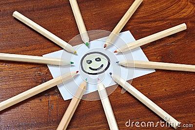 Pencil sun on wooden table
