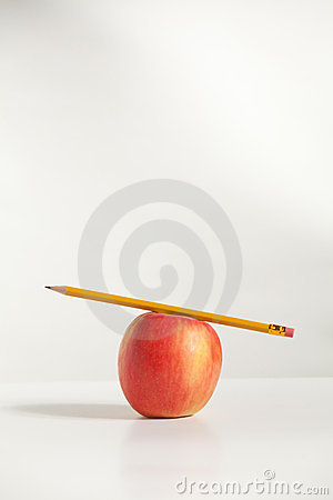 Pencil on top an Apple