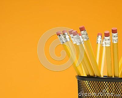 Pencils in holder.