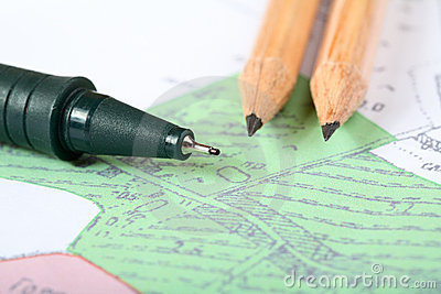 Pencils and marker on a  map