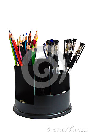 Pencils and pens in a glass