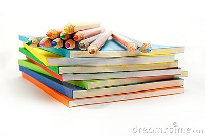 Pencils on the surface of the stack of books
