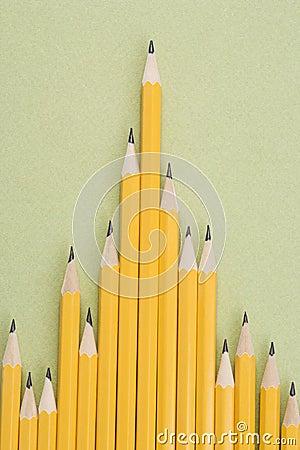 Pencils in uneven row.