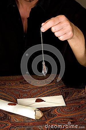Pendulum above letters