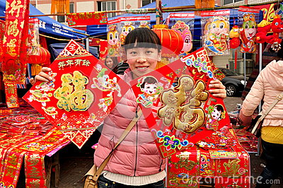 Pengzhou, CH: Woman Selling New Year Decorations Editorial Stock Photo