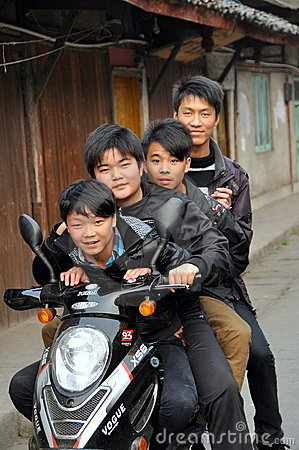 Pengzhou, China: 4 Teens on a Motorcycle Editorial Stock Photo