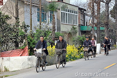 Pengzhou, China: Bicyclists on Country Road Editorial Photo