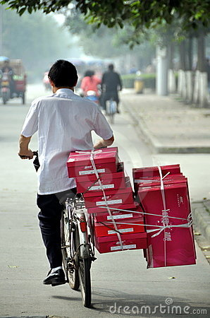 Pengzhou, China: Biker Delivering Packages Editorial Stock Photo